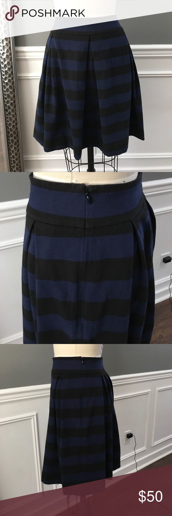 Kate Spade Pleated Skirt Jersey knit pleated skirt by Kate Spade from the skirt the rules line. Hidden side zip and clasp. Black and navy stripes. In excel condition just no longer fits me. kate spade Skirts