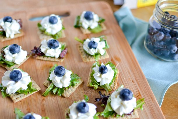 Triscuit Crackers topped with Balsamic Mixed Greens, Whipped Goat Cheese and Blueberries