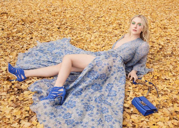 Dakota Fanning wears Jimmy Choo Rebel Soft Mini Bag and Keena Suede Sandal Booties