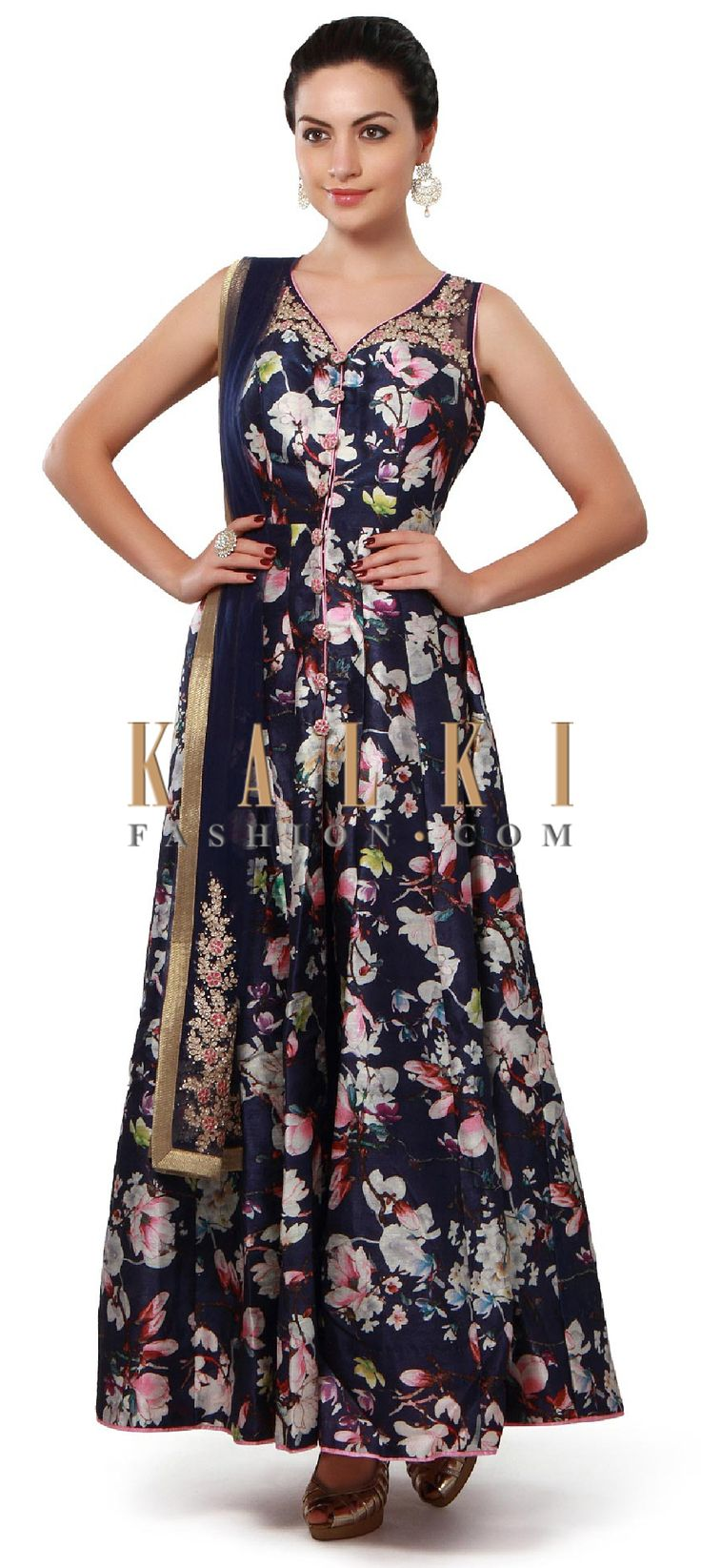 Buy Online from the link below. We ship worldwide (Free Shipping over US$100). Product SKU - 313604. Product Price - $299.00. Product link - http://www.kalkifashion.com/navy-blue-anarkali-suit-enhanced-in-thread-and-floral-print-only-on-kalki.html