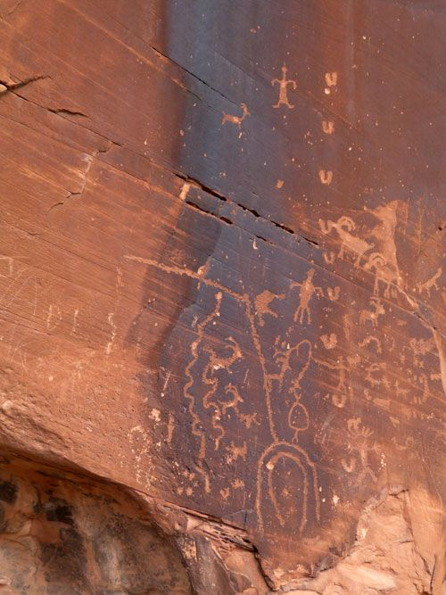 Moab -- American Indian petroglyphs.  I have seen these twice...spectacular.  What you can't see is these are carved on a giant naturally fractured piece of chert, which makes a natural concave amphitheater about 3-4 stories high.  Sadly, modern cretins have shot holes into it and defaced it with graffiti.