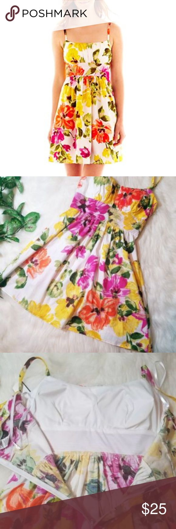 Garden Party Floral Sundress Full Skirt Perfect for any upcoming Spring or Summer gathering. Fancy enough for Graduation or Weddings, yet casual and comfortable enough for date night or a BBQ. Beautiful multi floral print with yellow, pink, orange and green. Thich spaghetti straps with zip up back. Padded chest with ruching, blocked waistlined that flows out to a full skirt. 97% cotton, 3% spandex. B. SMART Dresses