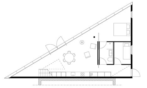Barend Koolhaas completes a blackened timber house with a triangular floor plan…