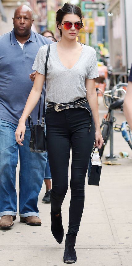 Kendall Jenner took something as basic as a gray tee and black high-waist skinnies and turned it into the chicest off-duty ensemble. She styled the winning casual combo with mirrored aviators, a Western-inspired studded belt, a mini Celine cross-body bag, and black boots.