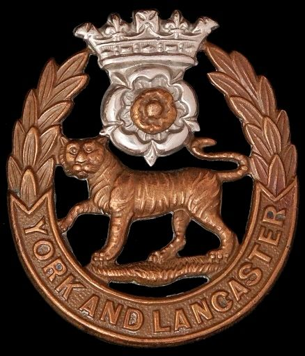 The famous 'cat and cabbage' (tiger and Tudor rose) badge of the York and Lancaster Regiment.