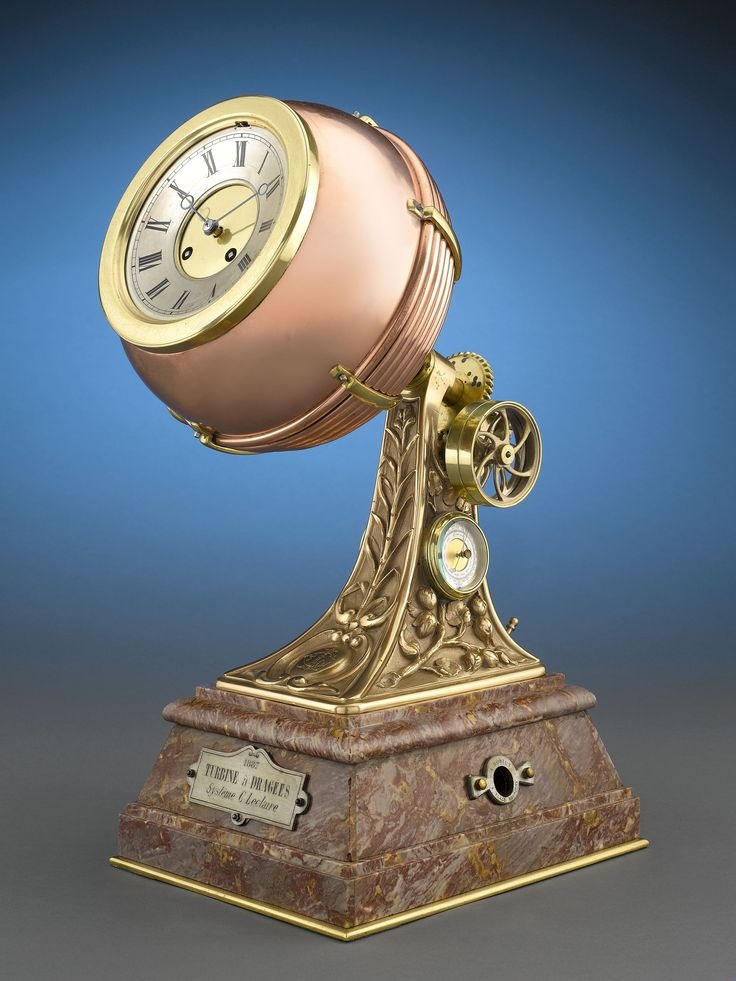 This rare and intriguing French industrial automaton clock takes the form of a turbine á dragées. This highly detailed timepiece was almost certainly crafted for the turbine's inventor. The clock's bell-striking movement is set within copper and gilt brass atop a stepped marble base. This clock is signed and dated 1887.