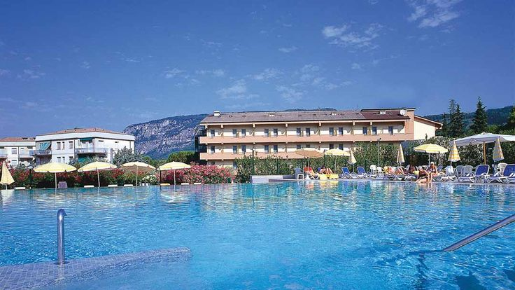Two minutes from the lakefront, La Perla Hotel is perfectly positioned for access to all of Garda's shops and restaurants. If you don't fancy getting out and about, spend the day on the large sun terrace by the outdoor pool, nestled among the foothills. #Summer #Holiday #Lakes #Mountains #Garda #Italy