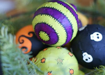 Halloween ornaments made from old Christmas ornaments and Mod Podge!