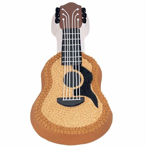 Acoustic Guitar Cake  -  Unplug from the rest of the world and create this Acoustic Guitar Cake. The main parts of the guitar—the fingerboard, tuners, bridge, headstock, and sound hole—are made with candy plaques.