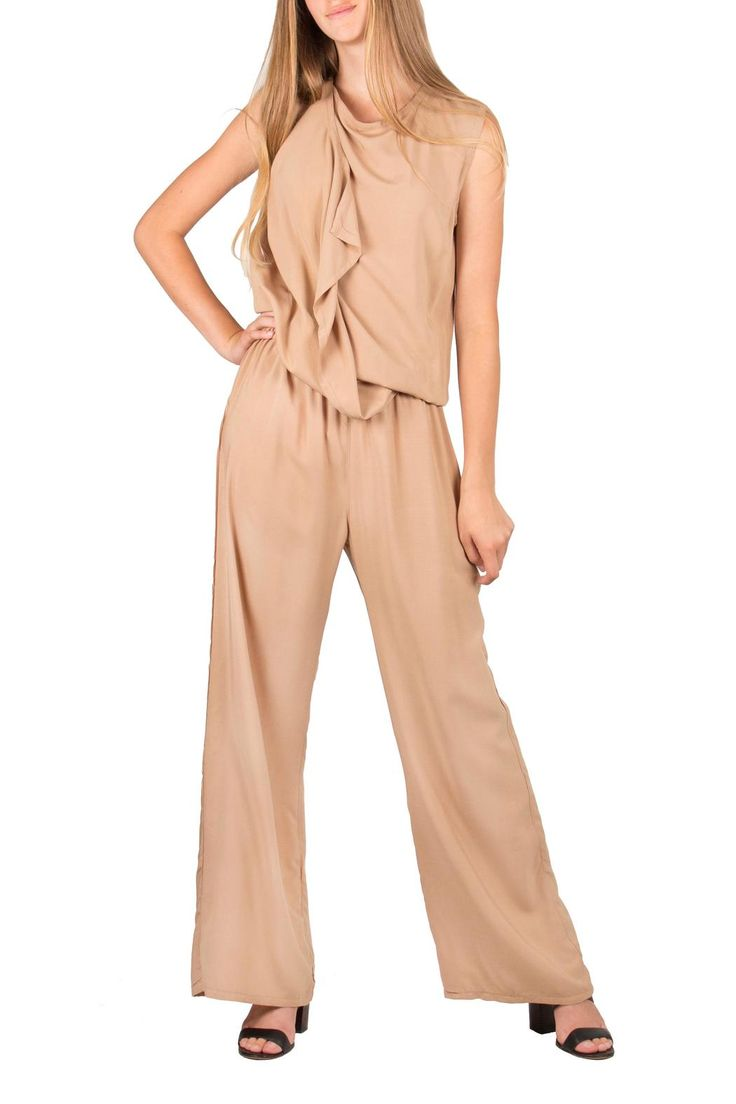 A beige jumpsuit with overlapping front panels and an elasticized waist. Made of a light woven viscose this jumpsuit is a must have for hot summer days.  Beige Jumpsuit by Lococina. Clothing - Jumpsuits & Rompers - Jumpsuits Canada