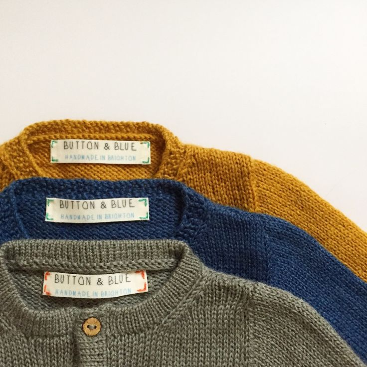 Baby cardigans in mustard, navy and grey wool                                                                                                                                                                                 More