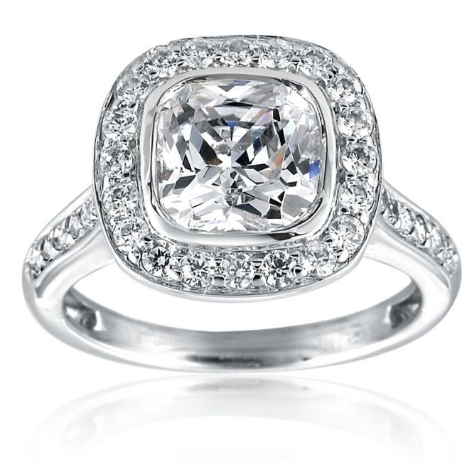 This ring is a premium and more modern version of the classic solitaire ring. The center stone is surrounded by a diamond halo that adds sparkle and makes the center diamond appear larger. A total of 48 diamonds (total weight 0.78ct.) grace this amazing ring and make it spark from any angle.