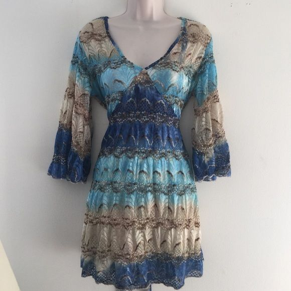 Per Una UK Lace Festival Dress Per Una from Mark's & Spencer UK Size UK 14 / US Large 8/10 Turquoise/Navy's/Beige lace Empire waist with ties V neckline Semi stretchy fabric Loose flowy sleeves. Can be worn as a tunic or as a dress. I paired it with a nude slip and wore it as loose fitted mini dress. Perfect for a festival or a day at the beach. Tops Tunics