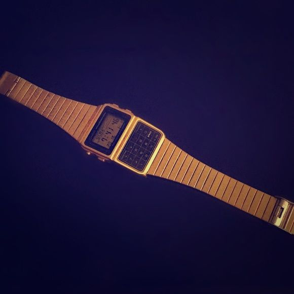Gold Casio Data Bank Watch Gold calculator watch. Authentic Casio. Good condition. Only wear on the underside of band. Really cool and super trendy. Casio Accessories Watches