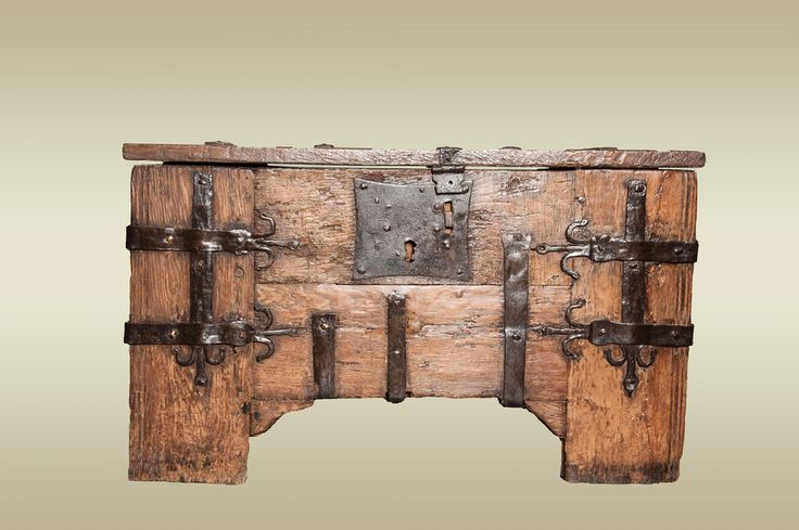 Small Medieval oak ironbound chest, clamp front in construction and the iron work consists of flat straps with fleur-de-lys motifs and a large butterfly lock plate.     Origin: Germany  Date: Circa 1400  Dimensions (inches): Width 36 1/2 x Height 21 3/4 x Depth 16