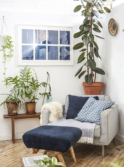 Use plants to mark out different areas within your home. Creating a cosy corner can be a challenge when you live in an open-plan space, but Jess has used plants in a couple of different ways to make one corner feel like the best place for relaxing. She chose a tall pot plant to provide a natural backdrop for a large armchair and footstool