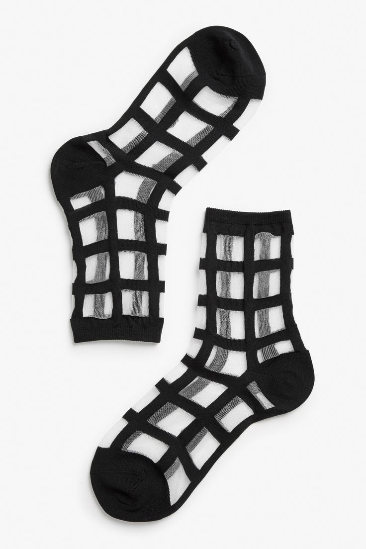 Keep your socks on. These black grid socks with mesh panels will give your feet a touch of orderly charm.