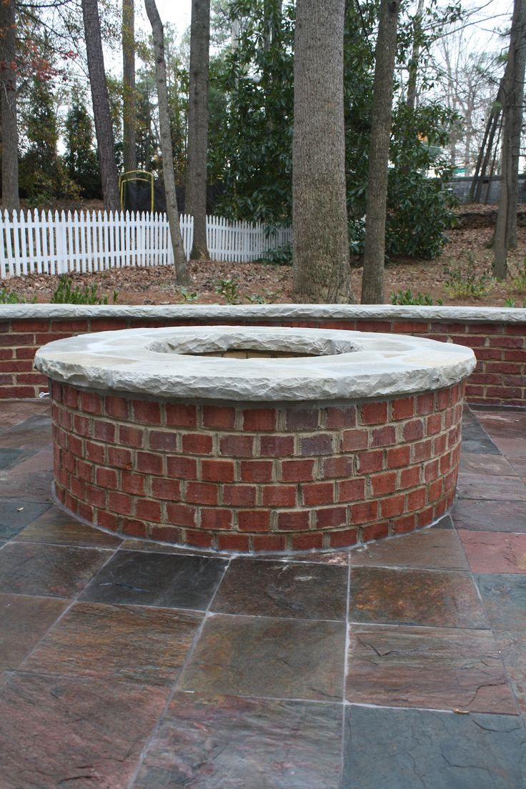 Red brick firepit with stone cap fireplaces and firepits for Brick fire pit construction