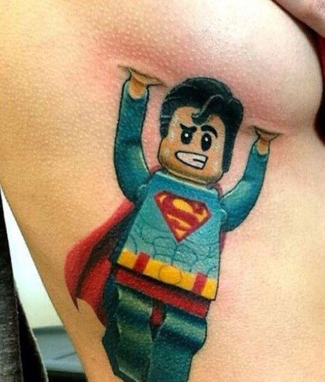 Lego Superman tattoo, lending a hand.
