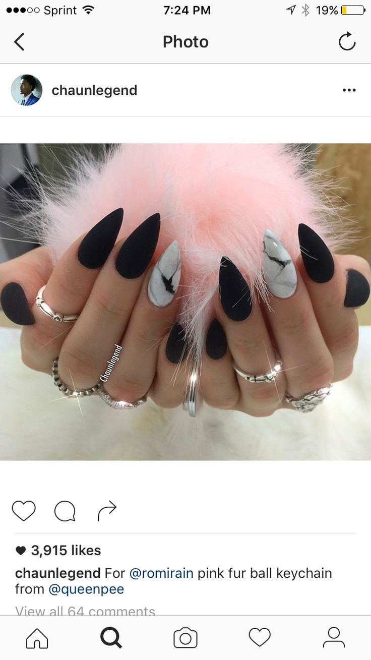 Umm yes pleas. Matte black and marble stiletto nails.