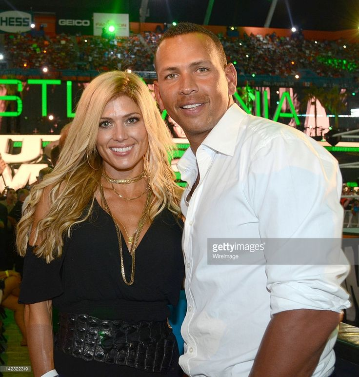 Torrie Wilson and Alex Rodriguez attend WrestleMania XXVlll at Sun Life Stadium on April 1, 2012 in Miami Gardens, Florida.