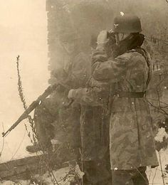 Fallschirmjager with mauser 98k, and another commander with binoculars