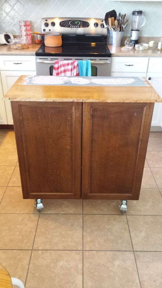 Flip a kitchen cabinet into a rolling island rolling for Build kitchen island with cabinets