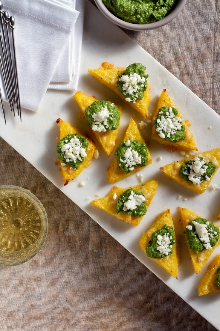 Broiled Polenta Bites with Green Harissa. Perfect for holiday appetizers!