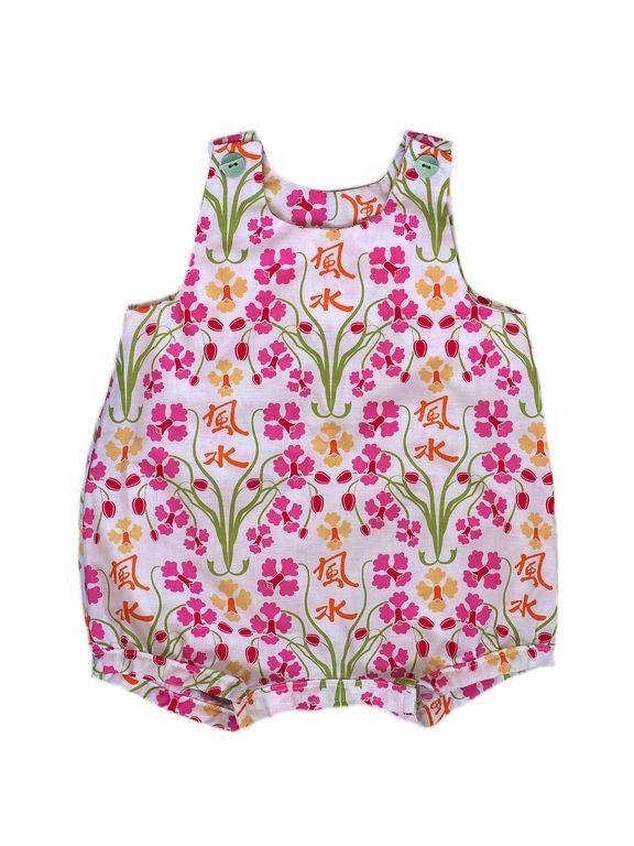 http://www.papaetmaman.fr/barboteuse-bebe-fille-coton-fleuri-manches-courtes-pression-fermeture.html