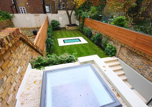 Glass covered lightwell for under garden basement