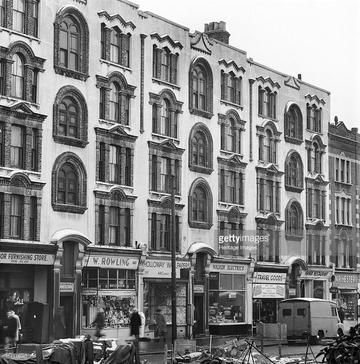 Albemarle Mansions, Holloway Road, Holloway, London, 1962-1964. An exterior view of the street frontage of Albemarle Mansions and the shops below at Nos 544 to 554 Holloway Road, Islington.