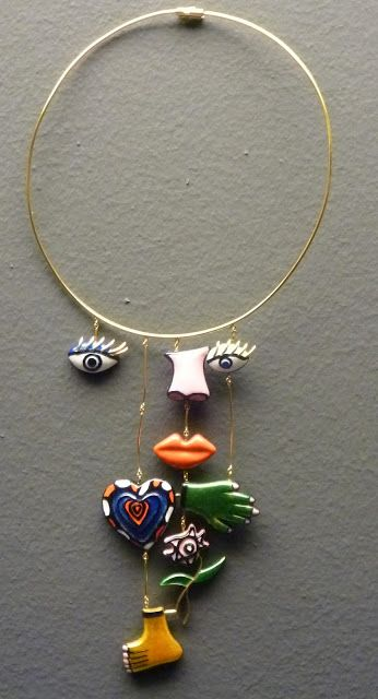 Avant garde Jewelry Design: Eyes + nose + lips + hand + feet collage collar necklace design | Niki de Saint Phalle, Visage (gold, enamel).