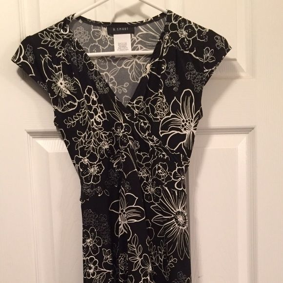 B. Smart black and white floral dress size 3/4 B. Smart black dress with white floral outline. Size 3/4. Ties in the back. Flowing bottom. Dresses