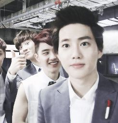 This picture says so much.... CHANYEOL BEING ALL CUTE IN THE BACKGROUND... Yo yo don't forget those Kyungsoo arms!!!