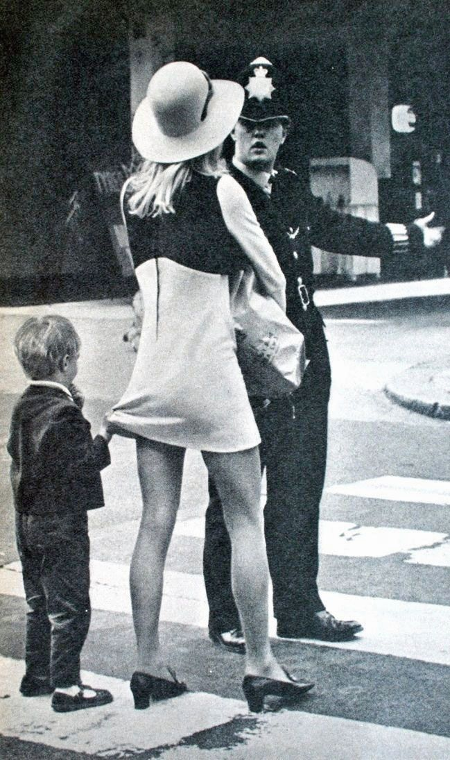 Child holding his mother's mini skirt in the street of London, 1968