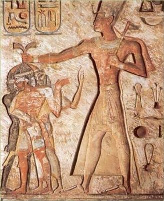 "☛ This carved relief created during the time of Ramesses II shows a Black, a Reddish ""White"" and an Asian (representing the three races of: SHaM [Shem], CHaM [Ham] and IPaT [Japheth]) being sacrificed to the Egyptian god Ammon."