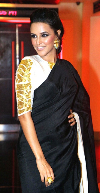 Not even a bit of skin, but Neha still looks stunning in a black formal Masaba saree.