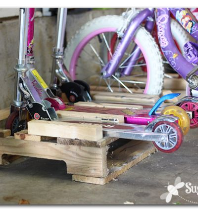 make a scooter and bike rack holder from a pallet - love this!