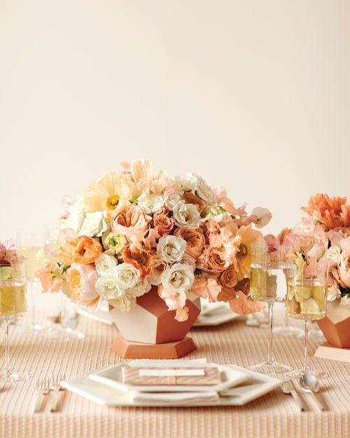 Romantic Majolica, garden, and spray roses make contemporary centerpieces when juxtaposed with geometric terra-cotta pots.