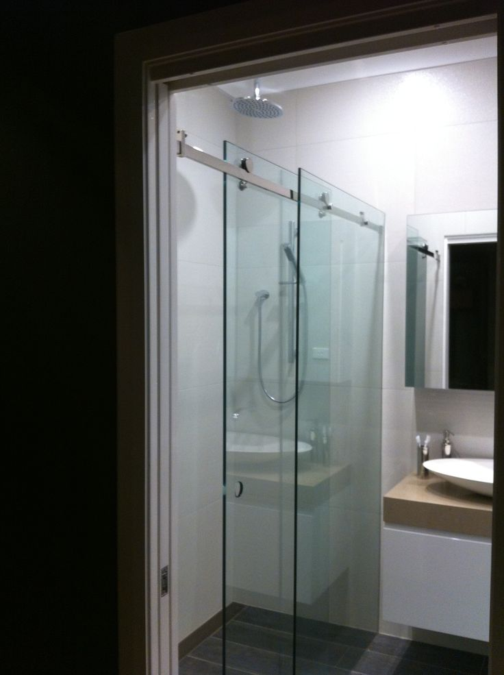 Looking into the bathroom from hallway - view is of the frameless double shower with sliding door
