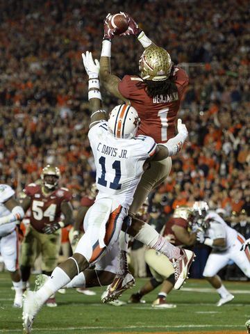 Florida State wide receiver Kelvin Benjamin catches the game-winning touchdown pass against Auburn cornerback Chris Davis in the BCS Nationa...