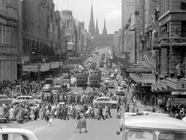 1957: Shoppers in Bourke St. Picture: Herald Sun Image Library