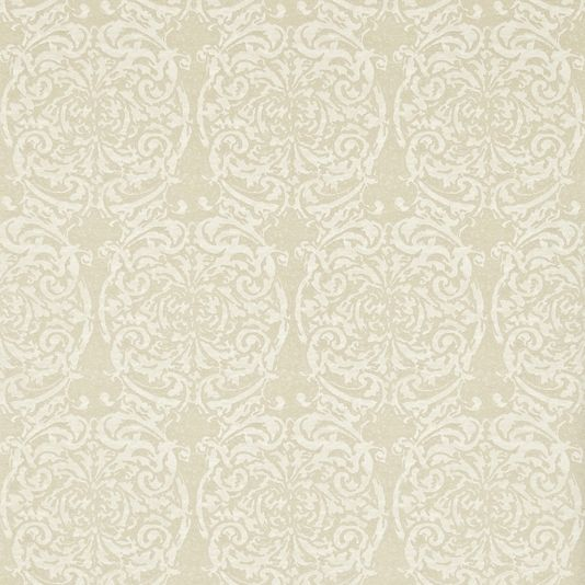 Tespi Wallpaper A statement wallpaper based on the ornate fabric by the same name and inspired by the scrolling oval damask motifs often used by Fortuny. The design is shown in shades of cream with pale gold highlights, and produced using a combination of raised inks and metallics printed by the rotary screen method to create the appearance of cracked and peeling paint.