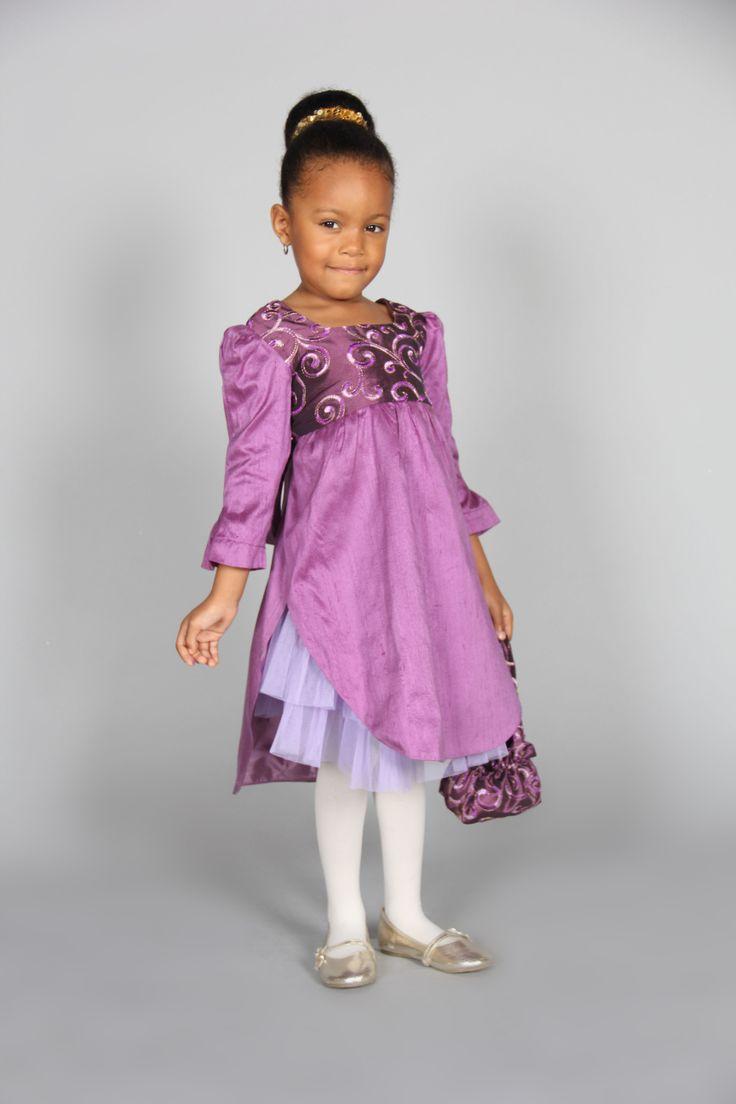 Genevieve dress - Silk taffeta dress with a bow sash with a tulip layered skirt.