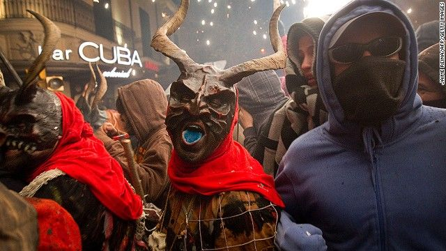 A reveler wearing a demon costume takes part in the traditional festival of Correfoc in Palma de Mallorca.