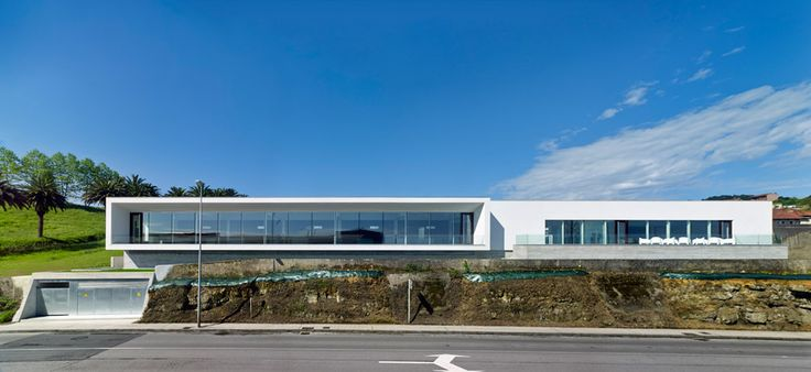 The Morgue of Jove by local studio AE Arquitectos is a 2,800-square-metre funerary facility located beside a hospital and facing an industrial port in the city of Gijón.