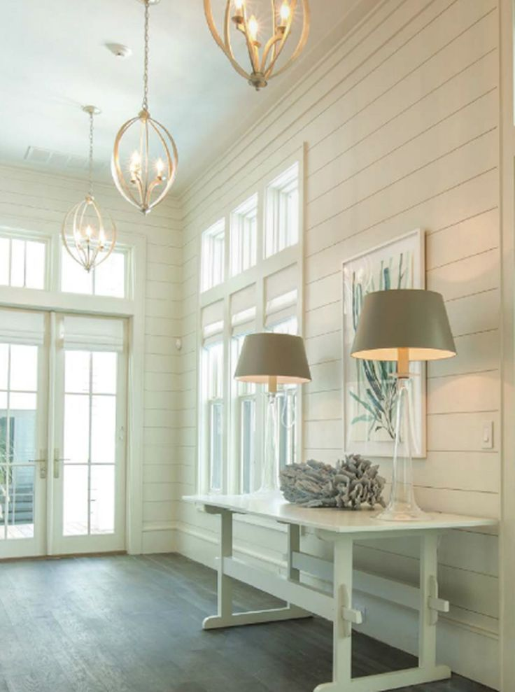 White horizontal paneling, in that cave of a mudroom. This would be inviting and look very pretty with your door knob hanger.