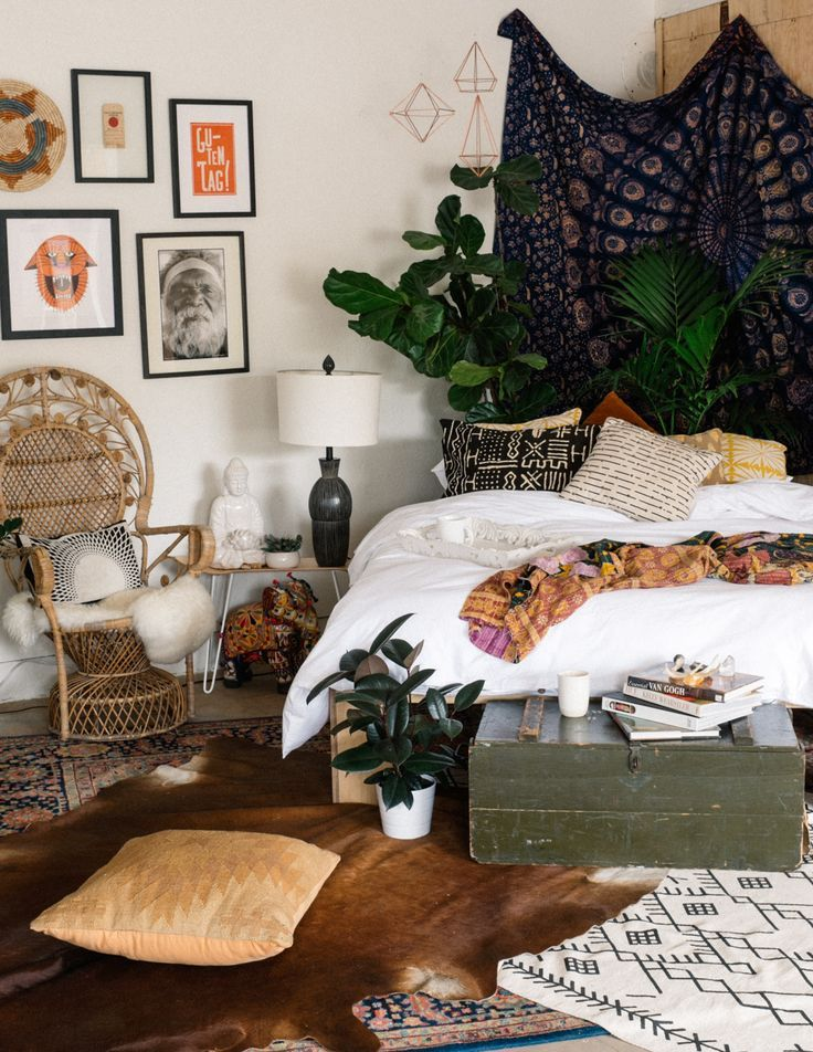King bed in the corner with plants and tapestry behind it. Make a platform bed frame. // Home Decoration Ideas