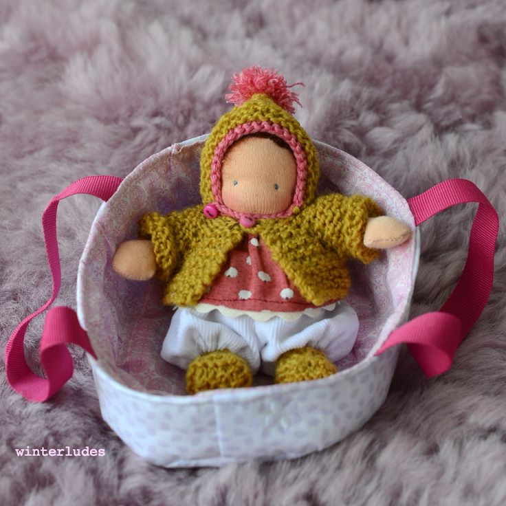 itty bitty baby H. in her bassinet. winterludes waldorf doll