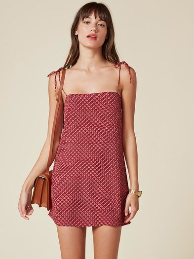 Slip into this. This is a micro mini length, relaxed fitting dress with a straight neckline.